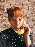 Courtney holding banana
